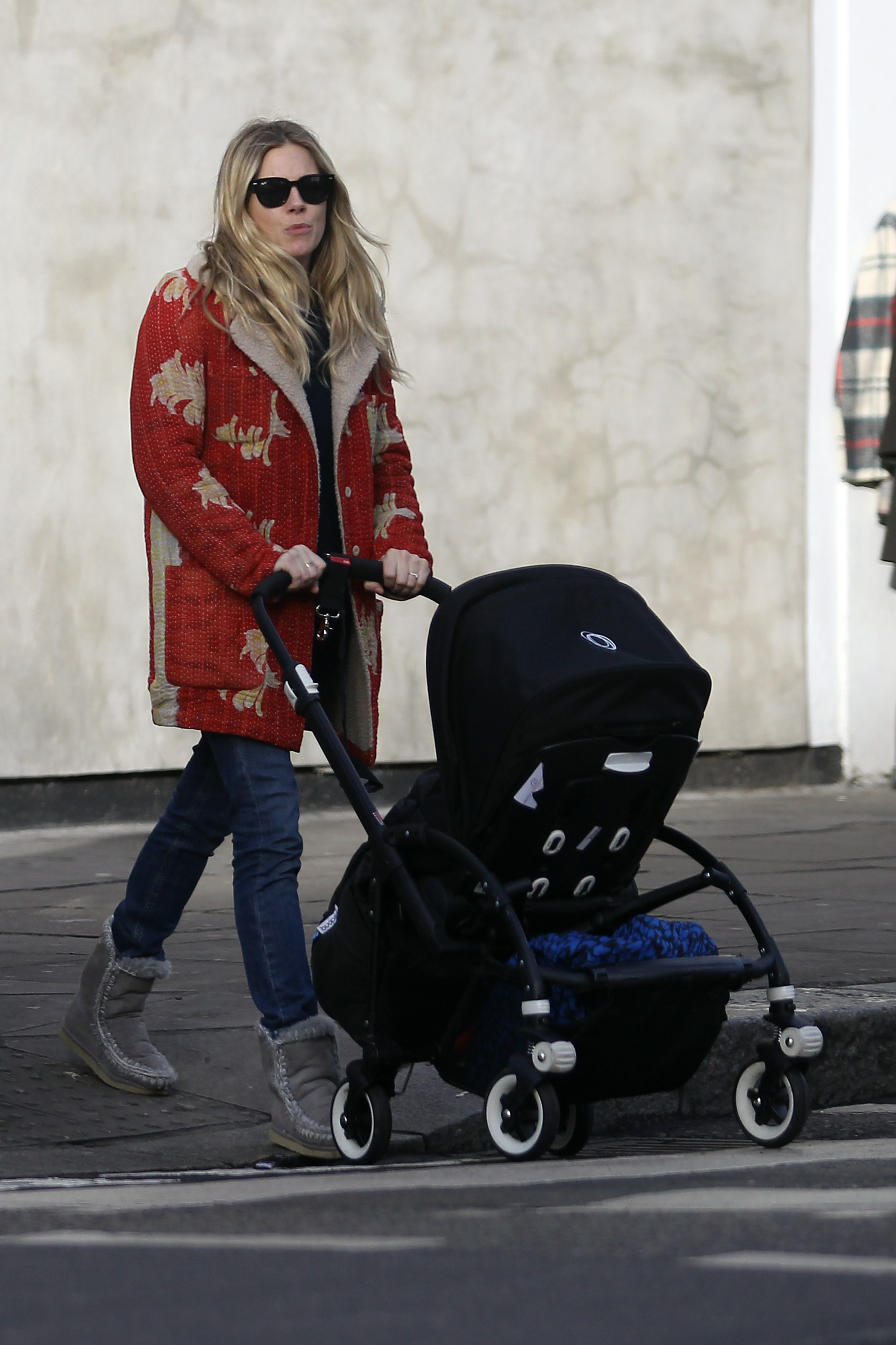 Sienna Miller wearing Mou Boots